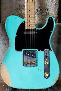 Fender Japan 69 Telecaster maple cap neck on a custom Surf Green worn nitro body