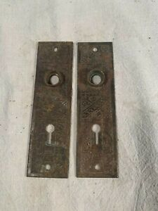 Victorian pair of Embossed Iron Door Knob Backplates circa 1890s 5&9/16in tall