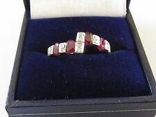 Secondhand 14ct Yellow Gold Oval Ruby Multi Diamond Twist Ring Size P.