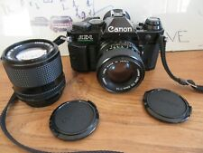 Canon AE-1 Program + 50mm f/1.4 New FD + 100mm f/2.8 New FD BEL ENSEMBLE