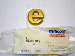"""NOS MoPar 1991-96 Jeep Cherokee GOLD """"e"""" NAMEPLATE 55294919"""