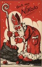 Santa Claus Packing His Bag LWKW Postcard Vintage Post Card