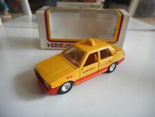 Tomica Dandy Toyota Corolla Sedan Taxi in Yellow/Red on 1:43 in Box
