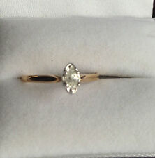 10K yellow gold engagement ring with marquise diamond