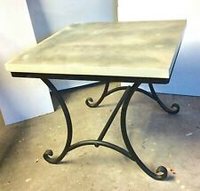 Square wood topped well built wrought iron based occasional table