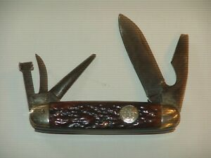 Remington scout knife - used - small chip in plastic on back
