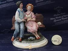 Coppia di fidanzati su panchina Capodimonte Carusio