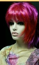Bright pink assemetrical wigs with orange highlights. Permatease Top w Volume .
