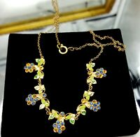 Vintage gold tone and blue rhinestones necklace.