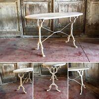 piétement de table bistrot en fonte de fer dessus bois patinée . XX siècle .