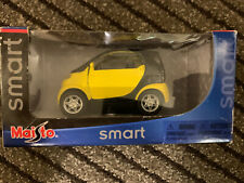 MAISTO SMART 1:33 YELLOW MOTORIZED PULL-BACK CAR NEW