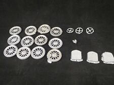 12 recast Britains tires & wheels, 3 radiator grills, 3 steering wheels, 1 lamp