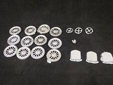 12 recast Britains tires & wheels, 3 radiator grills, 3 steering wheels, 1 lamp