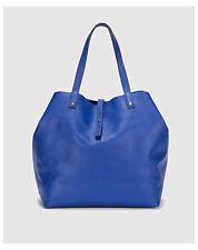 Sacs et sacs à main Cabas bleus en cuir pour femme