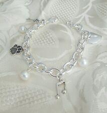 925  silver bracelet, w/  Freshwater Pearls& antique tibetan Charms.