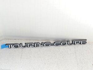 NOS Cadillac Touring Coupe Emblem Nameplate Exterior trim badge Eldorado