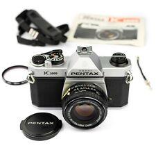 Nr. MINT… PENTAX K1000 35mm SLR CAMERA…(NEW SEALS etc…) + SMC 50/1.7 LENS… JAPAN