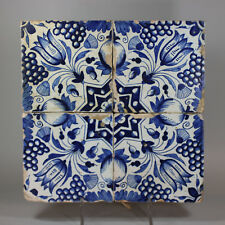 Antique Panel of four Dutch delft blue and white 'tulip' tiles, c. 1610-40