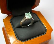 A 1.55ct Colombian Emerald Solitaire Ring