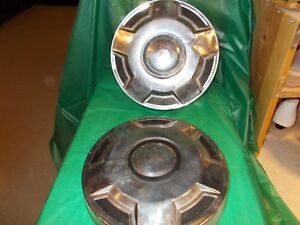 1985-89 FORD F-150-F250-F350 TWO USED HUBCAPS!!!!!