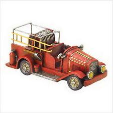 "Fireman Truck  Polyresin  7 1/4"" x 3 1/8"" x 3 1/4"" high"