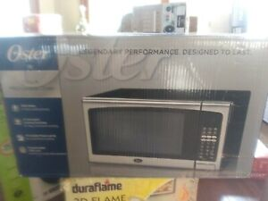 Oster 1.3 Cu. Ft. Countertop Microwave Oven - 1000 Watts - Stainless Steel Trim