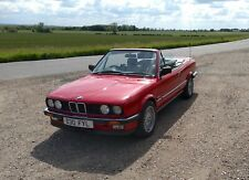 Classic BMW E30 325i 1986 Manual, in zinnobar red with black leather interior.