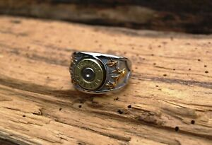 Heavy Stainless Steel Bullet Ring with Gold Deer Heads and Brass 30.06 Casing.