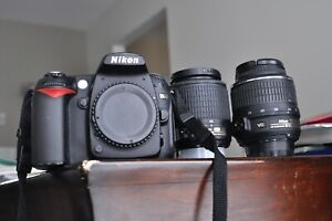 Nikon D90 camera body with two Nikon lenses and more