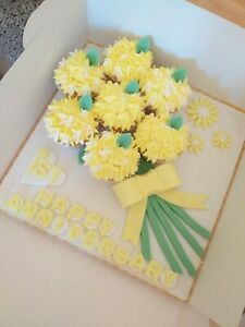 CUPCAKE BOUQUETS ANY COLOUR. ON 12IN BOARD £20 PLUS £5 DELIVERY IN MY LOCAL AREA