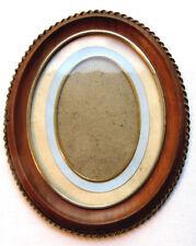 Cadre porte-photo, médaillon ovale bois peint, liserés laiton doré Napoléon III