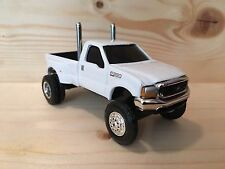 1/64 custom lifted, ford F350, Large Rubber Tires, G-5 Lift Kit, Dual Pipes Nice