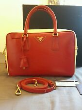 Used in excellent Prada BL0095 Saffiano Vernic  lux Leather Red & cream