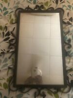 2 vintage mirrors framed with wrought iron