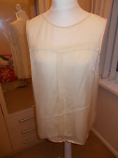 Cream shell sleeveless top with sheer panel size 14