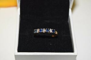9ct Yellow Gold Sapphire Eternity Ring Set With 3 Diamonds