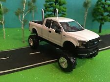 1/64 custom lifted 2015 ford f-150xl 4wd dual mufflers large mud pulling tires