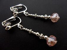 A PAIR OF SILVER PLATED PINK CRYSTAL   BEAD DANGLY CLIP ON EARRINGS. NEW.