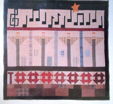 Song in the air Music fill air as angels watch over homes quilt pattern