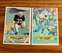 1983 Topps Sticker #1 Marcus Allen RC and #11 Tony Doresett