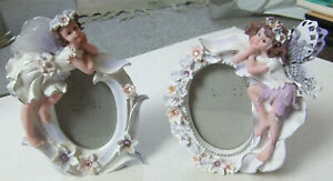 PAIR OF SMALL OVAL PHOTO FRAMES WITH FAIRIES DESIGNS - FREESTANDING