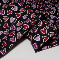 Tessuto cotone 100% fantasia cuori nero cm. 50x148/150