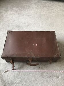 old brown leather suitcase