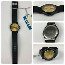 Vintage Casio Quartz 708 MW-60 Analog Black Strap Gold Face Watch Date Watch
