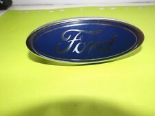 FORD MONDEO MK3 SWIVEL GRILL BADGE  IN GOOD CONDITION.
