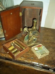 Brass old small cased Microscope-with slides/and attachments.-in case