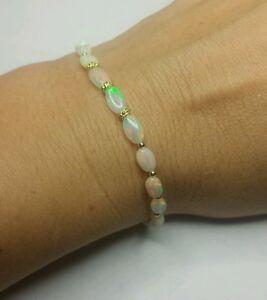 14k solid gold Genuine Ethiopian Fire Opal oval nugget bracelet bali flower bead