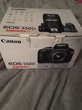 Canon EOS 550D Digital SLR Camera with lens and charger battery and box
