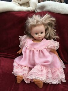 50cm old girl Doll in pink dress , needs a tidy up