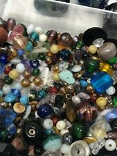 Divided bin of various pretty glass and ceramic beads